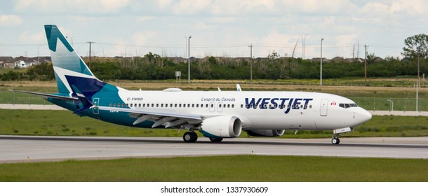 CALGARY, AB - June 21, 2018 A WestJet 737 MAX 8 lands at Calgary International Airport on its delivery flight from Boeing