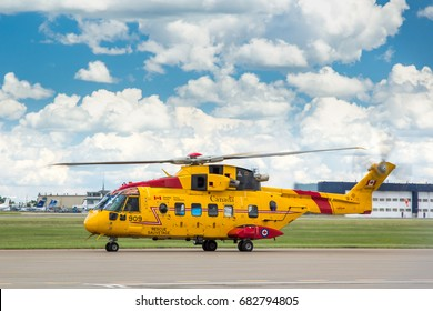CALGARY, AB - JUNE 24, 2017 A Canadian Forces Cormorant Helicopter prepares to depart Calgary International Airport
