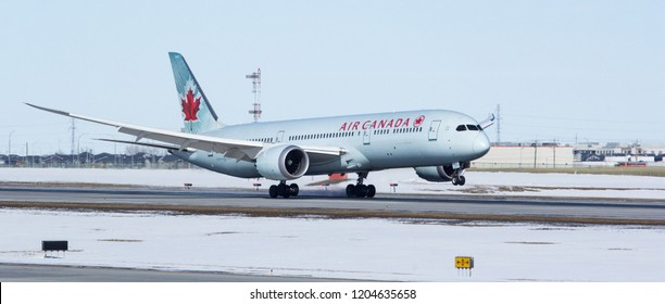 CALGARY, AB - March 23, 2018 An Air Canada Boeing 787 Dreamliner touches down at Calgary International Airport