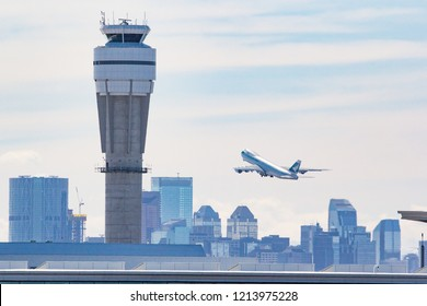 CALGARY, AB - March 23, 2018 A Cathay Pacific Boeing 747 Cargo Jet departs Calgary International Airport with the Control Tower in the foreground