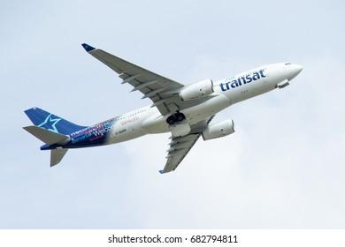 CALGARY, AB - MAY 16, 2017 An Air Transat Airbus A330 departs Calgary International Airport