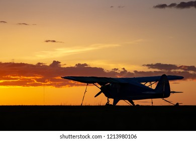 CALGARY, AB - May 5, 2018 A small, single engine airplane parked at a small general aviation airport at sunset