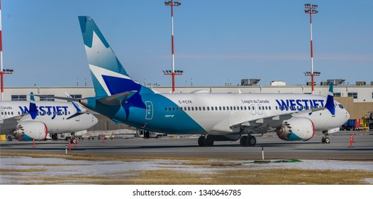 Calgary, AB/Canada - 03 15 2019: WestJet's grounded Boeing 737 Max 8 air crafts following Ethiopian Airline flight 302 crash parked in Calgary International Airport