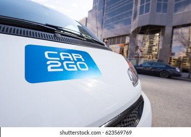 Calgary, Alberta, Canada - April  17, 2017 - A car2go fleet car parked on the street in downtown Calgary.  Car2go is a popular, convenient & inexpensive carsharing company that has fleets worldwide.