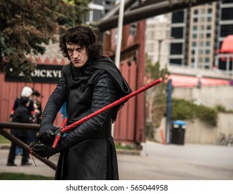 Calgary, Alberta, Canada, April 29 2016: Comic and Entertainment Expo Parade Kylo Ren unmasked cosplay holding his lightsaber menacingly