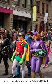 Calgary, Alberta, Canada, April 29 2016: Comic and Entertainment Expo Parade Robin and Batgirl march