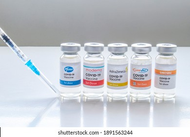 Calgary, Alberta, Canada. Dec 31, 2020. Several vials vaccine bottles of covid-19 immunization popular vaccines brands in the world. Concept: Different types brands of covid-19 vaccines.