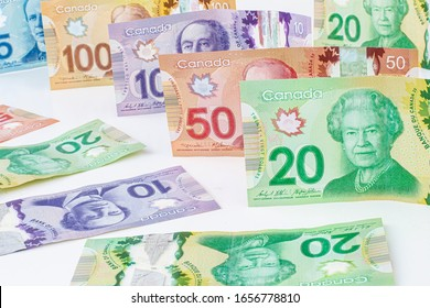 Calgary Alberta, Canada. Feb 25, 2020. A Collage of Canadian currency bills on a white background