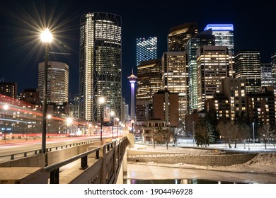 Calgary Alberta Canada, January 20 2021:A long exposure night photograph of a downtown Canadian City with light trails from vehicles crossing a bridge.