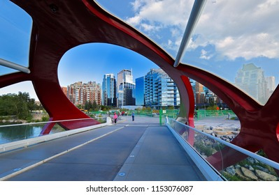 Calgary, Alberta Canada - July 11, 2018: View of Peace Bridge at Calgary AB Canada on a sunny afternoon. Peace Bridge is a pedestrian bridge, designed by Spanish architect Santiago Calatrava.
