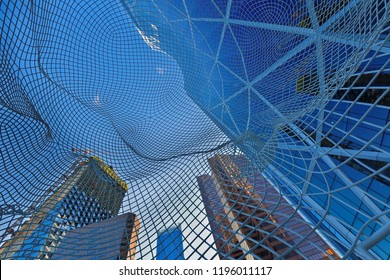 Calgary, Alberta Canada - July 11, 2018: Look Through the Wonderland Sculpture also known as Big Head in Downtown of Calgary, AB Canada.