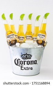 Calgary, Alberta, Canada. June 07, 2020. A bucket of Corona beer bottles with ice and limes.
