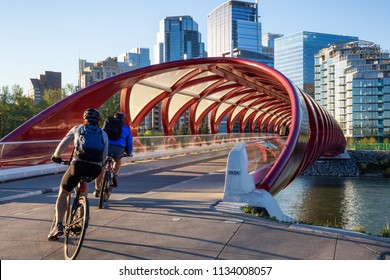 Calgary, Alberta, Canada - June 18, 2018: Peace Bridge across Bow River during a vibrant summer sunrise.