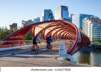 Calgary, Alberta, Canada - June 18, 2018: Peace Bridge across Bow River during a vibrant summer sunrise.