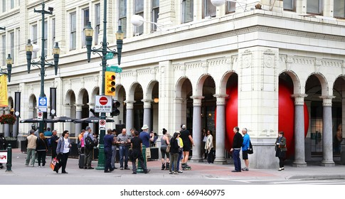Calgary. Alberta. Canada.  June 29 2017.  Red Ball project in Calgary downtown, Stephen Avenue.  The ball was trapped inside Hudson Bay's pillars.
