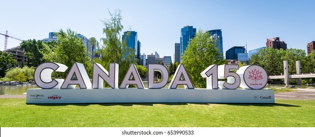 Calgary, Alberta, Canada - May 28, 2017: Canada 150 sign constructed in downtown Calgary in Prince's Island Park to commemorate Canada's 150th anniversary of Confederation in 2017.
