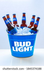 Calgary Alberta, Canada. Nov 01, 2020. A Bud Light Beer Bucket with six beer bottles with ice on a white background.