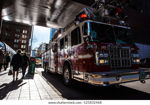 Calgary, Alberta, Canada, November 10 2016: Firetruck parked on the side of the street along 1st ST SW downtown Calgary Alberta