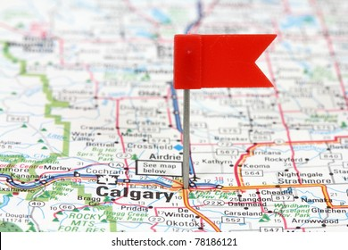 Calgary in Alberta, Canada. Red flag pin on an old map showing travel destination.