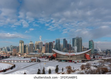 Calgary, Alberta - January 29, 2021: View of Calgary's skyline in winter with the Scotiabank Saddledome in the foreground.
