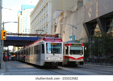 CALGARY, ALBERTA - JULY 29: C-Trains approaching station in Calgary on July 29, 2014. C-Train is the light rail transit system in Calgary, Alberta, Canada