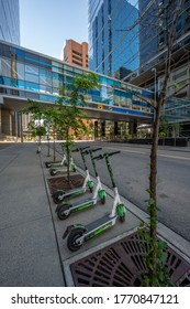 Calgary, Alberta - July 5, 2020: Lime scooters lined up and ready for commuters in downtown Calgary Alberta.