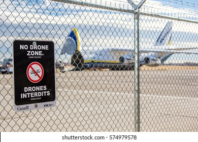"Calgary, Alberta - November 9, 2016. A Transport Canada ""No Drone Zone"" side affixed to a fence at Calgary International Airport"