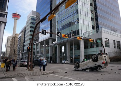 Calgary, Alberta/Canada - January 17, 2018: a car was involved in a traffic accident and flipped over.  Onlookers discussed the incident and speculated what may have happened.