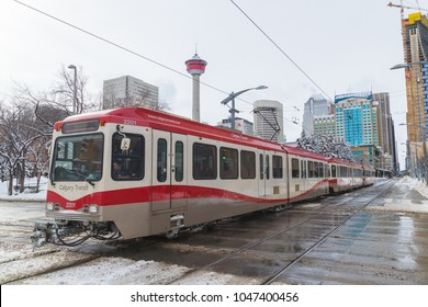 CALGARY, CANADA -  4TH MARCH 2018: Streets of Calgary in the winter. Showing trams, snow, roads and architecture.