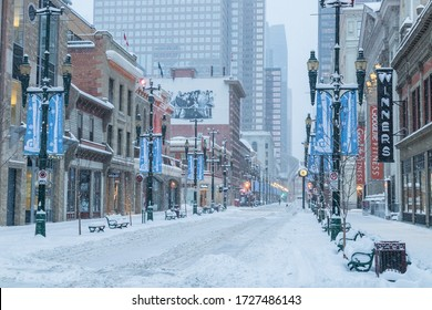 CALGARY, CANADA -  4TH MARCH 2018: A view along Stephen Avenue Walk in Calgary during the morning in the winter. Showing snow, architecture and roads.