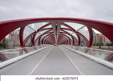 Calgary, Canada - April 17, 2017 - Looking down the unique & symmetrical Peace Bridge in Calgary, Alberta.  The pedestrian bridge spans across the Bow River and was designed by Santiago Calatrava.