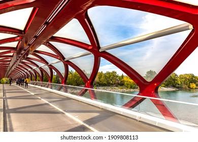 CALGARY, CANADA - APRIL 2, 2020: Peace Bridge across Bow river in Calgary in a sunny day, Canada