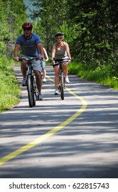 Calgary, Canada - August, 07, 2009: Cyclists on a rural road inside of Banff National Park near to Calgary. Banff National Park is Canada's oldest national park, established in 1885.