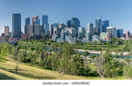 CALGARY, CANADA - AUGUST 5, 2019: Panoramic image of the skyline of Calgary on a sunny day with blue sky on August 5, 2019 in Alberta, Canada