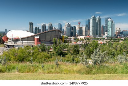 CALGARY, CANADA - AUGUST 5, 2019: Panoramic image of the skyline of Calgary with the Saddledom in the foreground on August 5, 2019 in Alberta, Canada