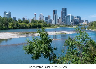 CALGARY, CANADA - AUGUST 5, 2019: Panoramic image of the skyline of Calgary with the Bow River in the foreground on August 5, 2019 in Alberta, Canada