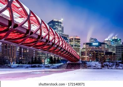 CALGARY, CANADA - FEB 18: the Peace Bridge on February 18, 2013 in Calgary, Alberta Canada. The pedestrian bridge spans the Bow River and was designed by Santiago Calatrava. Skyline in background.