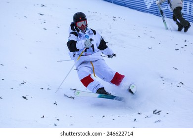 """CALGARY CANADA JAN 2 2015. FIS Freestyle Ski World Cup, Winsport, Calgary Mr. Unidentified  """"F1"""" Pre Runner from Canada at the Mogul Free Style World Cup on practice day."""