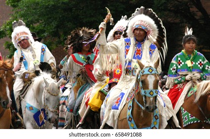 CALGARY,  CANADA - JUL 9, 2004  - Plains Indian on horseback, Calgary Stampede Parade,  Alberta, Canada