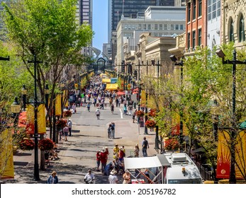 CALGARY, CANADA - JULY 13: Busy Stephen Avenue in Calgary during Stampede on July 13, 2014 in Calgary, Alberta Canada. This shopping and pedestrian plaza is the heart of downtown Calgary.