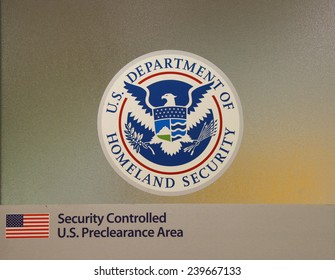 CALGARY, CANADA - JULY 26: U.S. Department of Homeland Security area at Calgary International Airport terminal on July 26, 2014.
