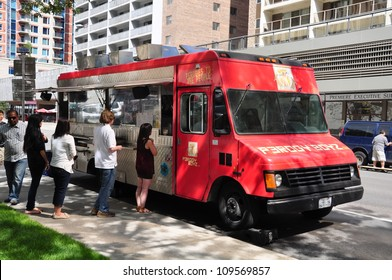 CALGARY, CANADA - JULY 27: Perogy Boyzs food truck on July 27, 2012 in Calgary, Alberta selling perogies to office workers in the urban center of Calgary. The popular trucks are new to the city.