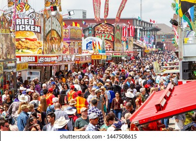 CALGARY, CANADA - JULY 9, 2019: A crowd filled the street on Olympic Way SE at the annual Calgary Stampede event. The Calgary Stampede is often called the greatest outdoor show on Earth.