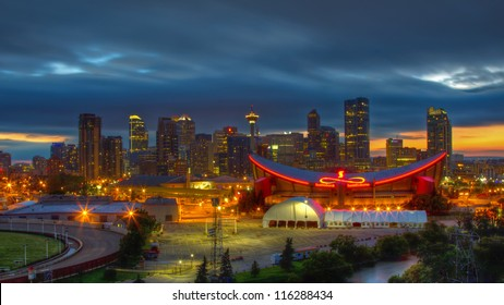 CALGARY, CANADA - JUNE 25: Night view of Calgary skyline on June 25, 2012 in Calgary, Alberta with the Calgary Saddledome in the foreground. Saddledome is the home of the Calgary Flames of the NHL.