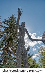 Calgary, Canada - June 29, 2018: Public Art resembling early people of the Canadian landscape stand majestically in downtown Calgary, Canada