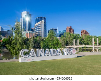 CALGARY, CANADA - JUNE 3: Special installation Canada sign celebrating Canada's 150 birthday on June 3, 2017 in Calgary, Alberta. The Calgary skyline and the famous Bow River is in the foreground.