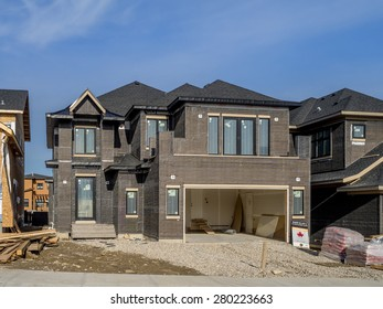 CALGARY, CANADA - MAY 17: Suburban estate home under construction in Aspen Woods on May 17, 2014 in Calgary, Alberta. This estate home is typical of upscale Calgary suburban districts.