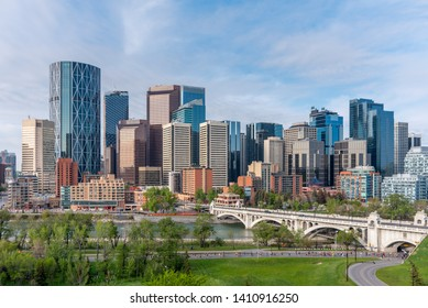 Calgary, Canada - May 26, 2019: Calgary's skyline on a spring morning. Runners participating in the Calgary Marathon are visible on Memorial Drive in the foreground.