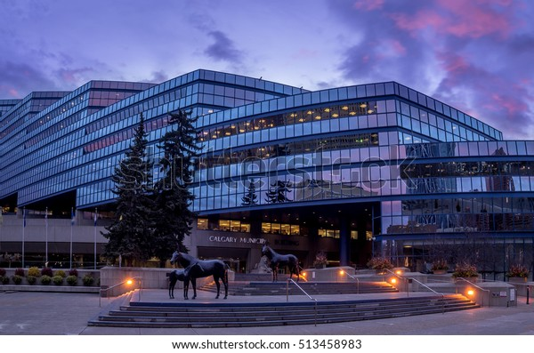 CALGARY, CANADA - NOV 6: Panorama of city hall at sunrise in Calgary on November 6, 2016  in Calgary, Alberta Canada. This building houses city hall. Municipal Plaza is in the foreground.