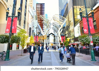 CALGARY, CANADA -SEPTEMBER 29 ,2017: Pedestrians walking past retail outlets along Stephen Ave in Autumn, Calgary, Alberta. Stephen Ave is a famous pedestrian mall in downtown Calgary